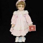 Dynasty Doll Collection Porcelain Doll With Pink Dress