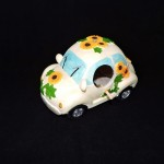 White VW Bug Birdhouse With Sunflowers